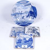 A group of Dutch Delft tin-glaze items, including tiles and January plate, diameter 24cm (4)