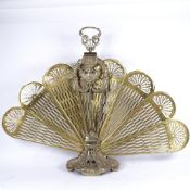A Victorian brass peacock fire screen, overall height 70cm