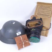 A Second World War Period British Army Brodie steel helmet, an ARP first aid pouch, and a