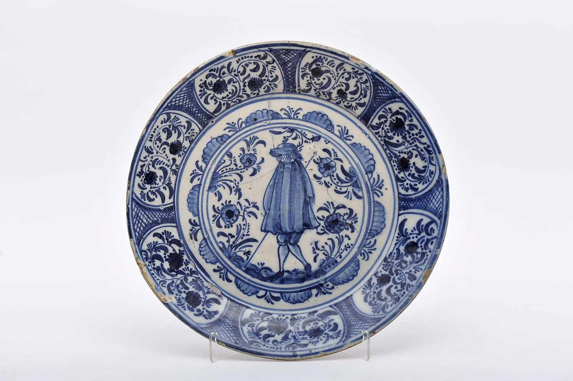 "Los 63 - A DishA Dish, Lisbon stoneware known as 'Mount Sinai', blue decoration ""Nobleman with cape and..."