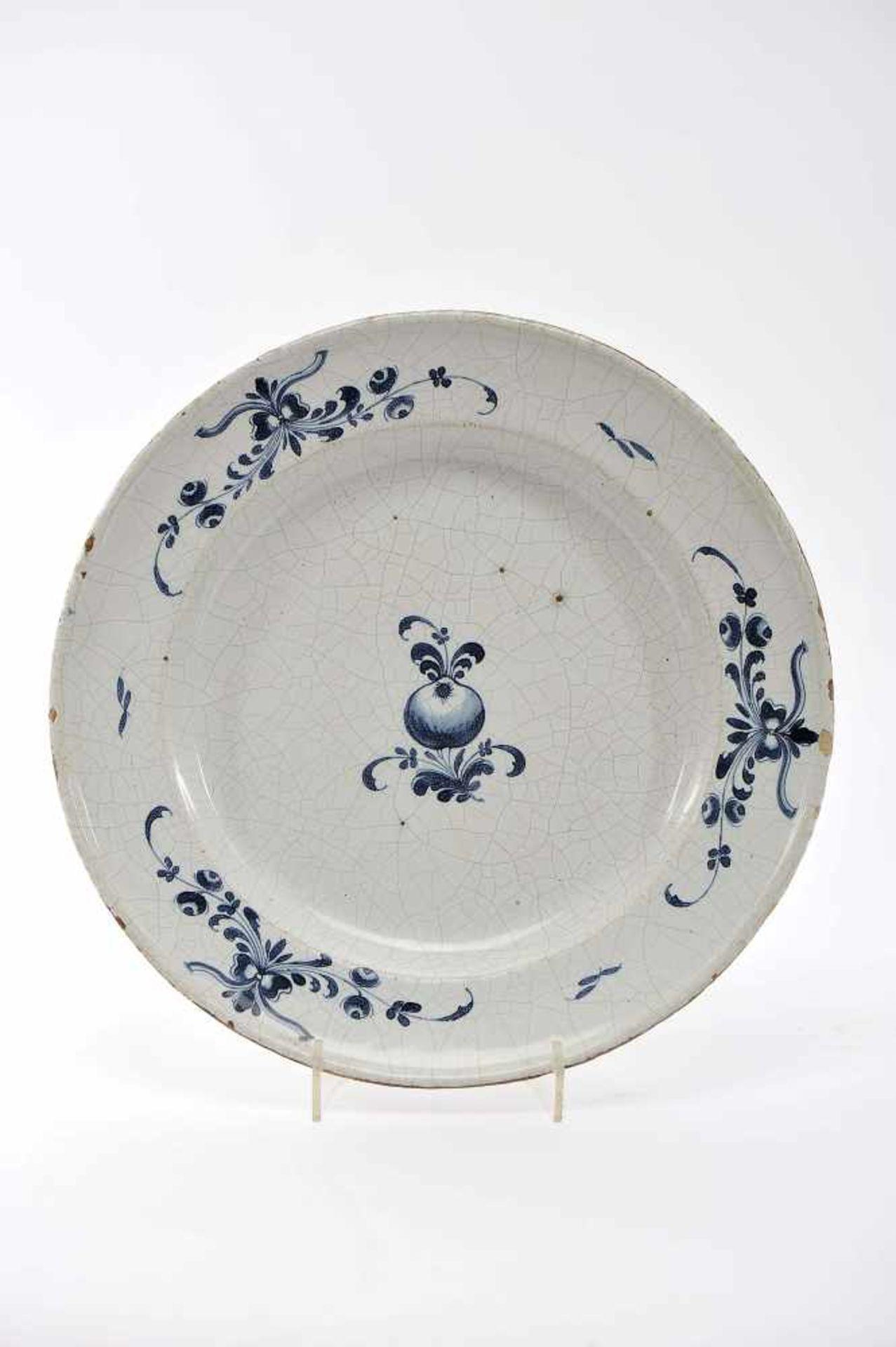 "Los 76 - A Large DishA Large Dish, Viana do Castelo faience, blue decoration ""Fruits and flowers"",..."