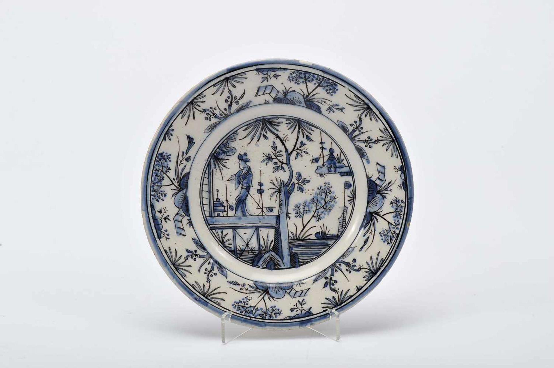 "Los 54 - A Small DishA Small Dish, faience, blue and vinous ""Desenho Míudo"" decoration ""Figure of Chinese..."