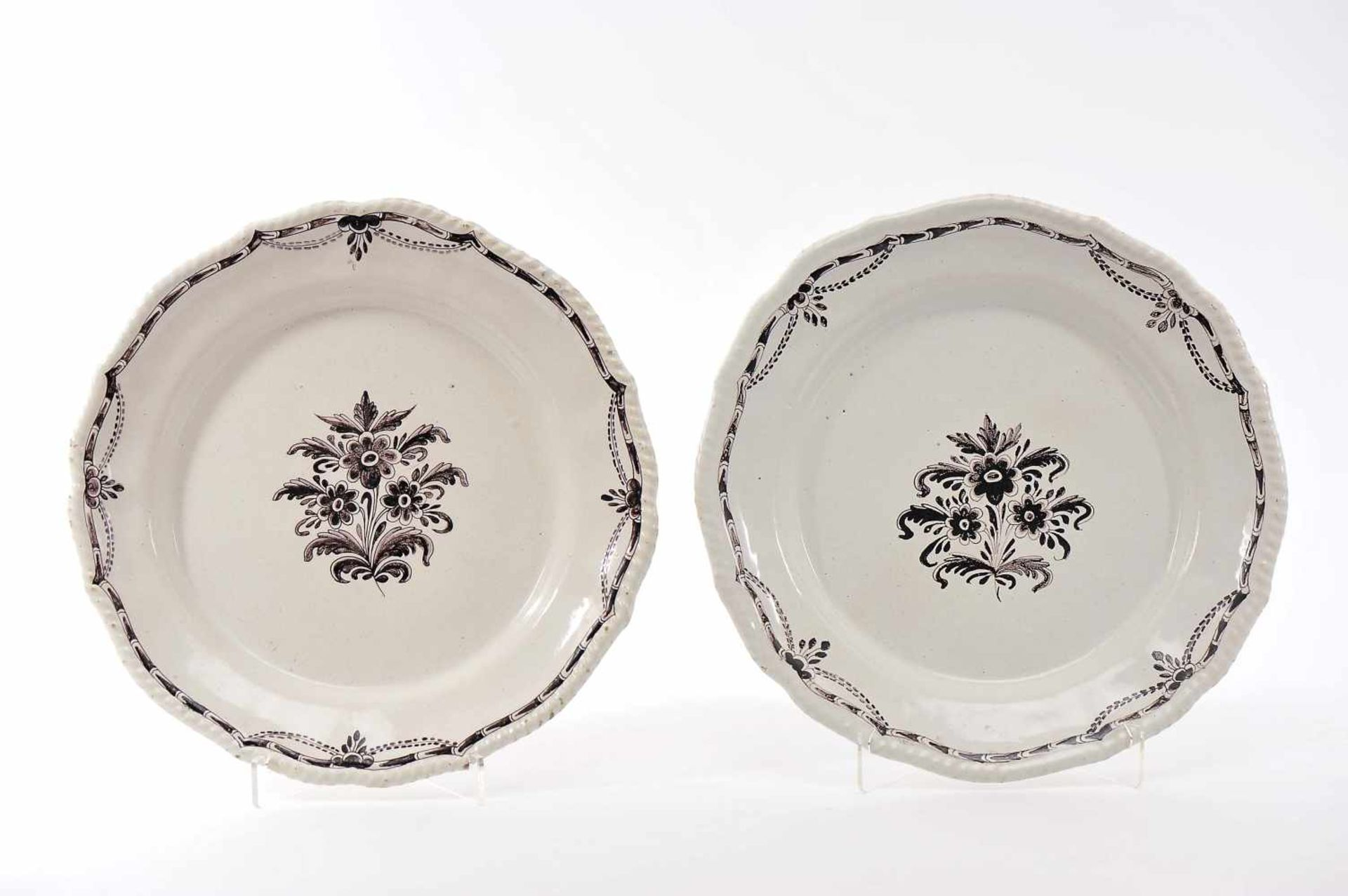 Los 74 - A Pair of Large Scalloped DishesA Pair of Large Scalloped Dishes, Viana do Castelo faience,...