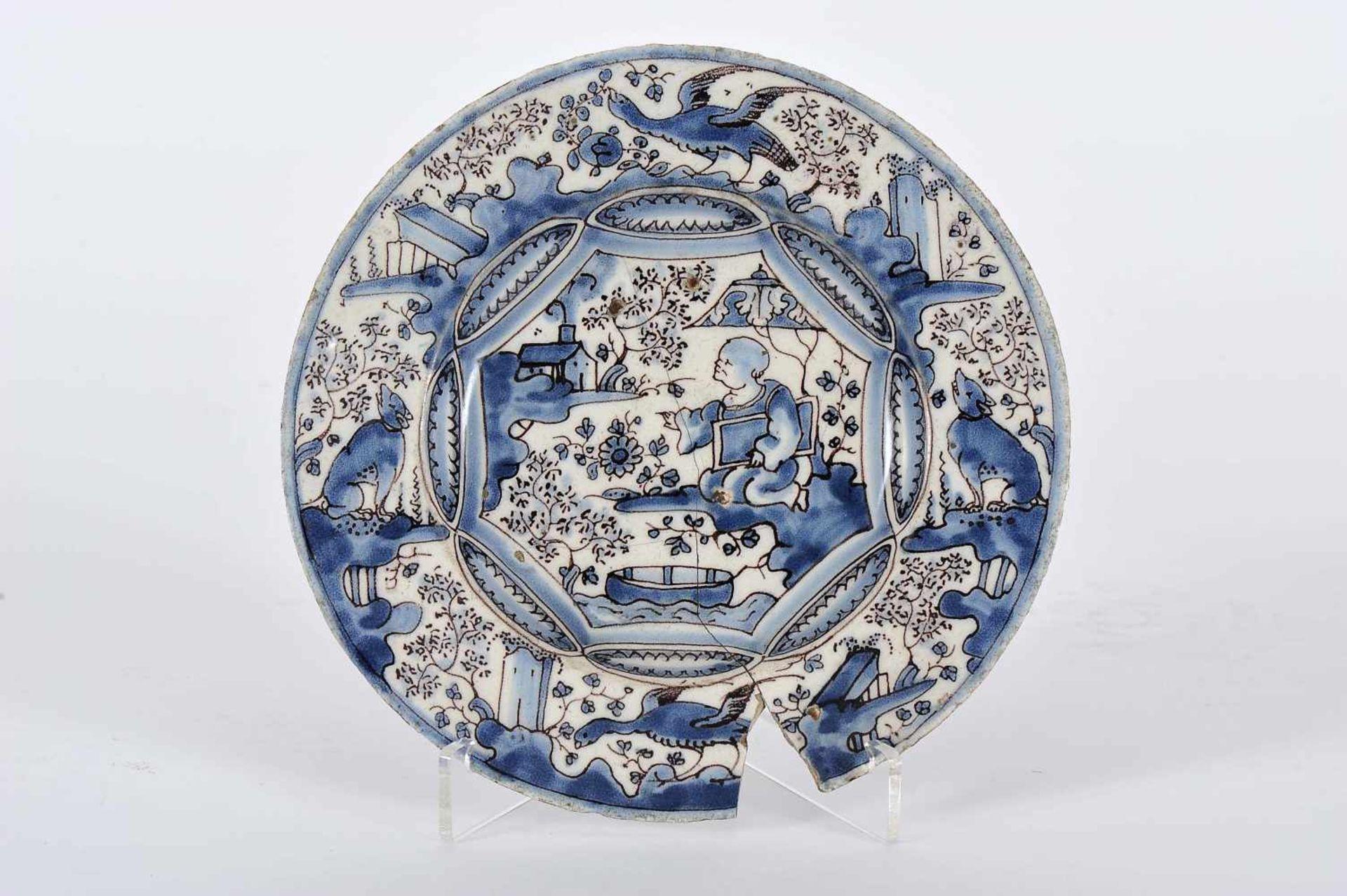 "Los 64 - A Small DishA Small Dish, faience, «Desenho Miúdo» blue and vinous decoration ""Chinese figure,..."