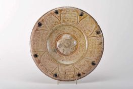 A Large Plate with Raised CentreA Large Plate with Raised Centre, faience, copper and blue