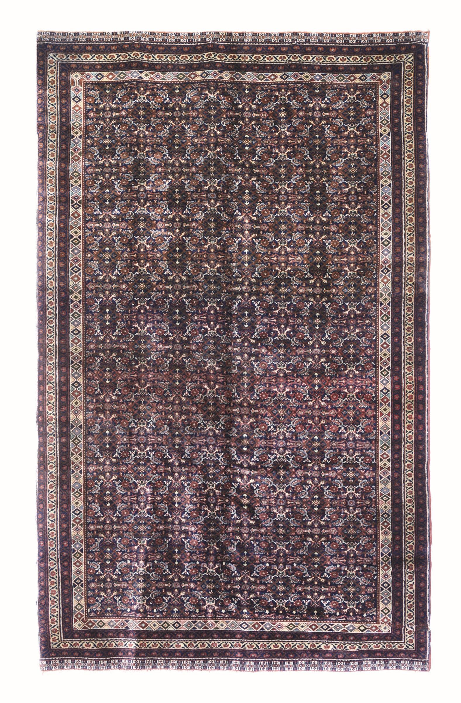 Tappeto Europeo, inizio XX secolo, - campo blu scuro con decoro herati, cm 240x152 -