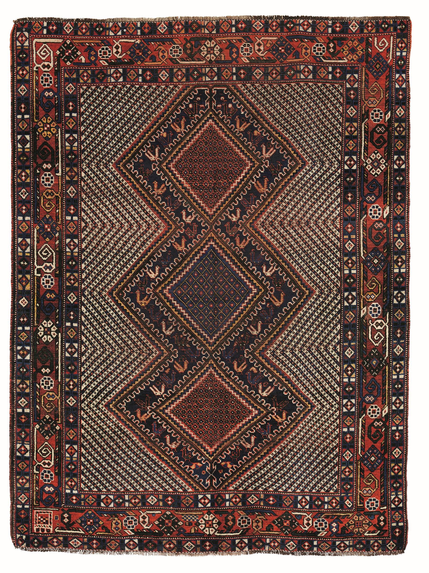 Tappeto Kamseh, sud Persia fine XIX inizio XX secolo, - particolare il campo con tre [...]