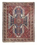 Tappeto Kazak Sevan, Caucaso fine XIX secolo, - campo mattone con ampio medaglione [...]