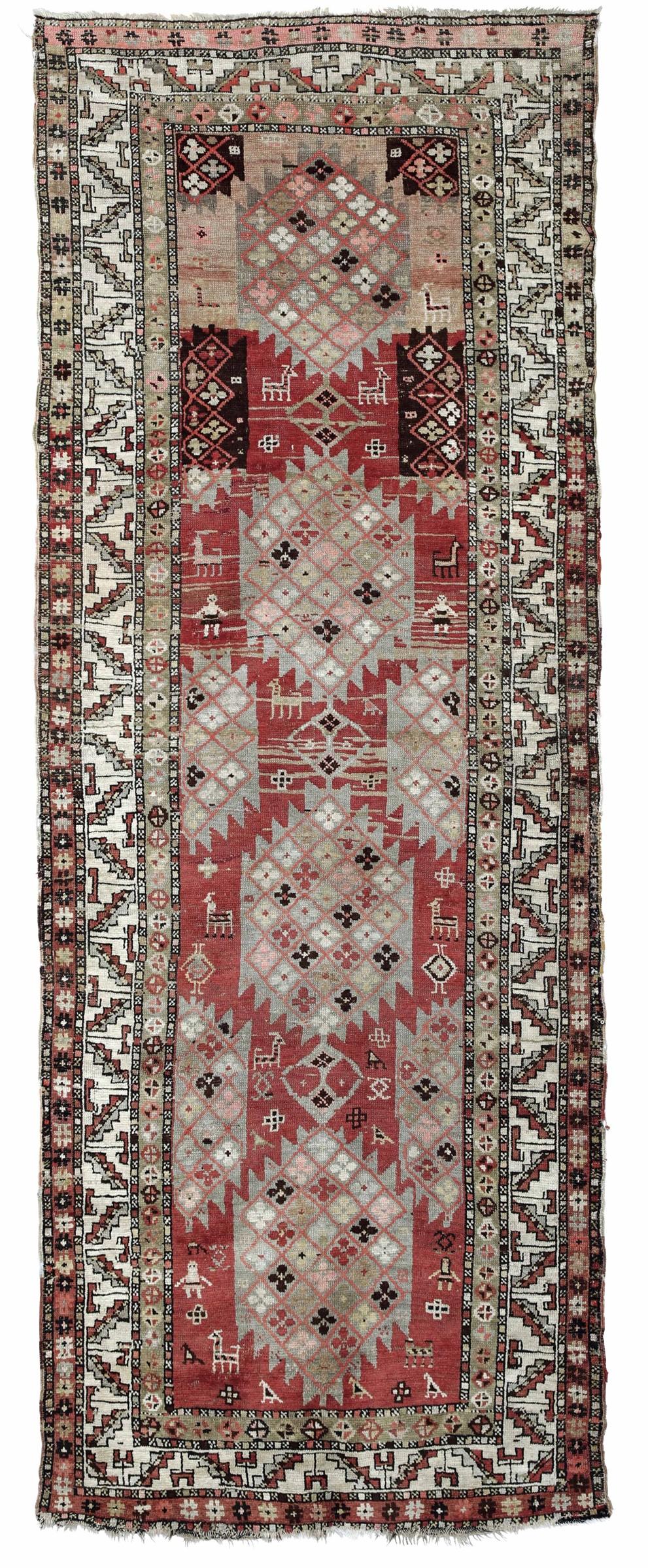 Passatoia Caucaso inizio XX secolo, - campo rosso con quattro medaglioni, figure ed [...]