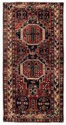 Tappeto Koneghand, Caucaso inizio XX secolo, - campo rosso con due medaglioni [...]