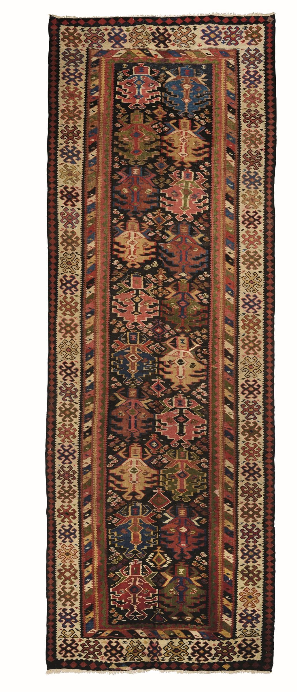 Kilim Curdo fine XIX inizio XX secolo, - campo marrone con due file di particolari [...]