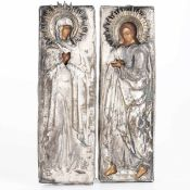 Due piccole icone con riza in metallo argentato raffiguranti Maria Maddalena e [...]
