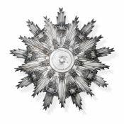 Grande aureola a raggiera in argento sbalzato e cesellato. Italia XVIII secolo. [...]
