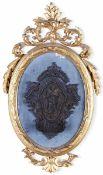 Acquasantiera in argento sbalzato e cesellato raffigurante Vergine Immacolata entro [...]