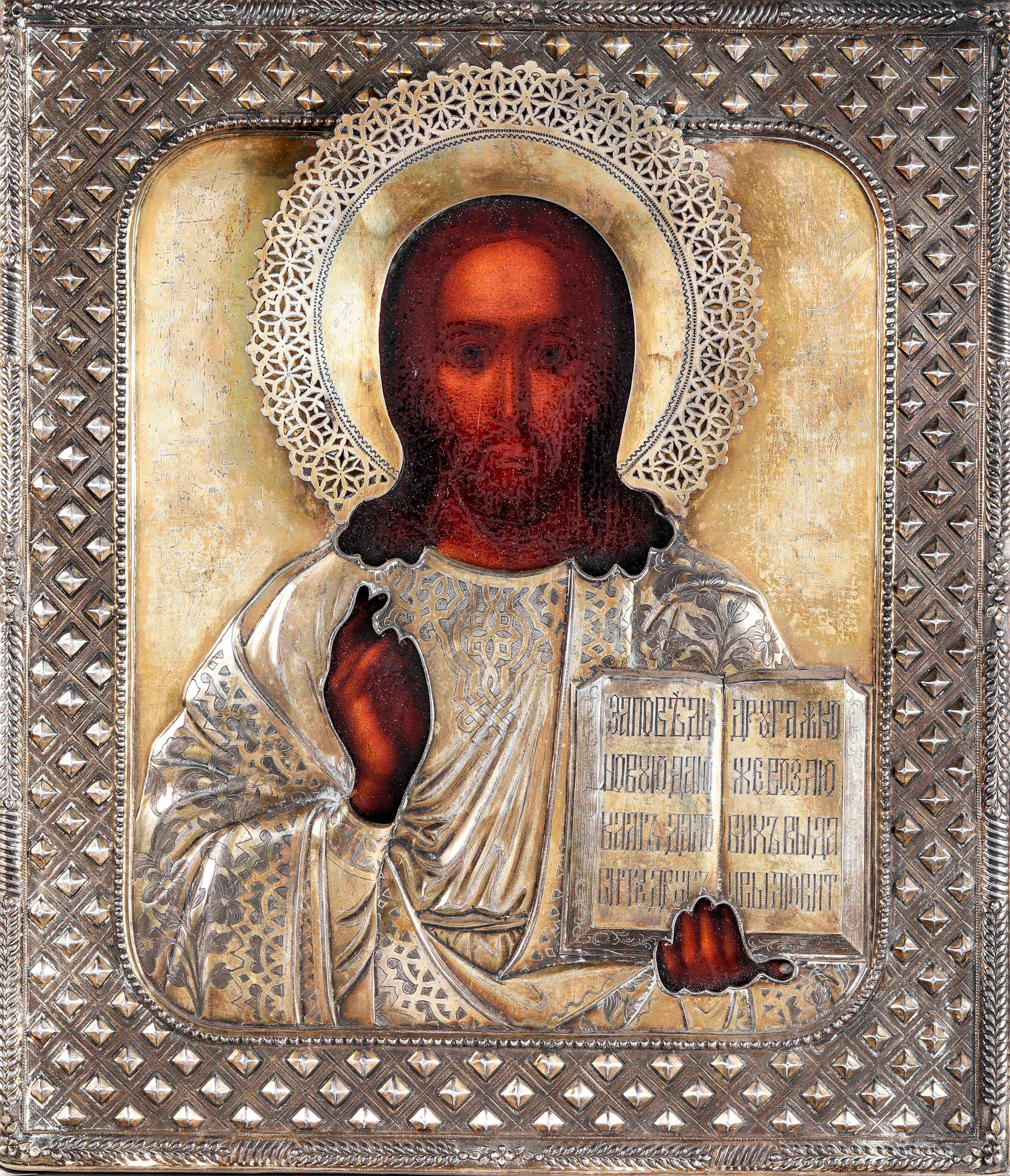 Icona con riza in argento sbalzato, cesellato e dorato raffigurante Cristo [...]