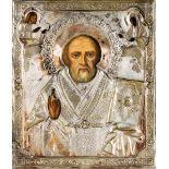 Icona con riza in argento sbalzato e cesellato raffigurante San Nicola. Russia XIX-XX [...]