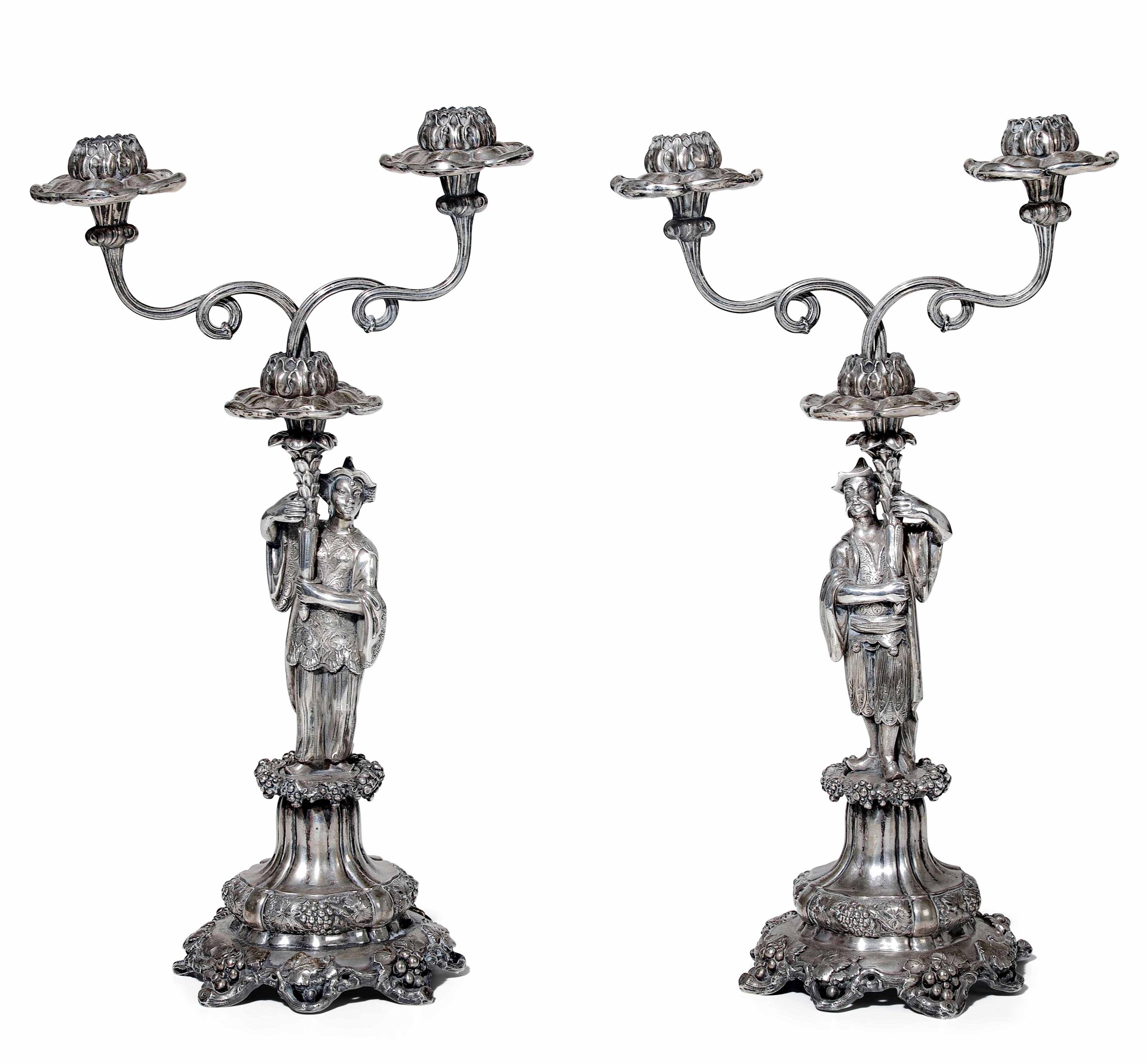 Two silver candlesticks, Austro-Hungarian Empire - Two silver candlesticks with [...]