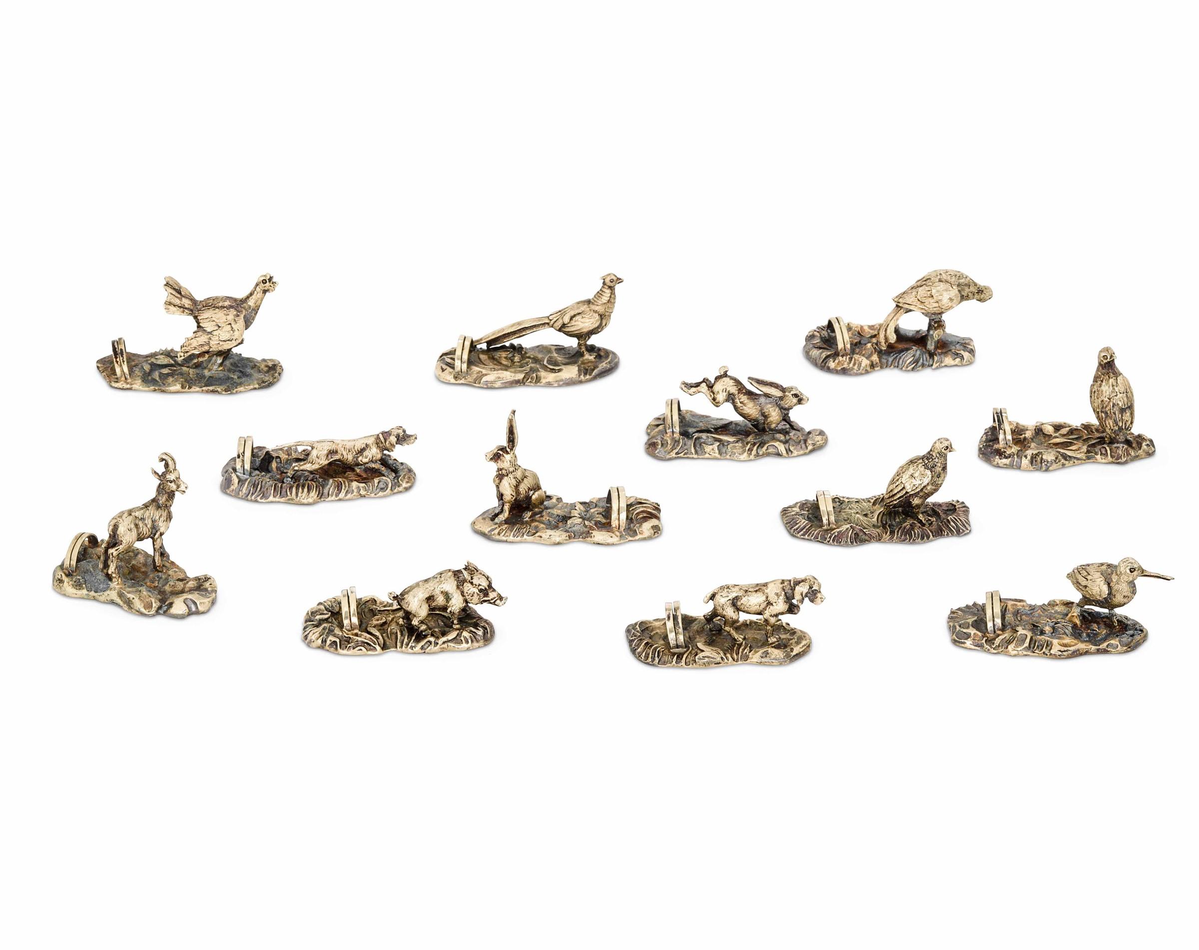 Set di 12 segnaposto in argento modello animalier. Argenteria italiana del XX secolo. [...]