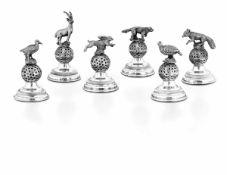 Sei segnaposto in argento e legno a foggia di animali da caccia. Argenteria italiana [...]