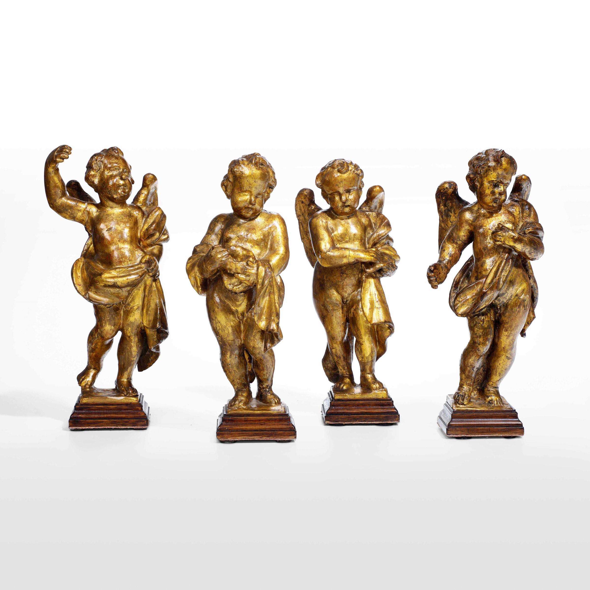 Four gilt wood putti, Italy, 1600s - cm 31 -