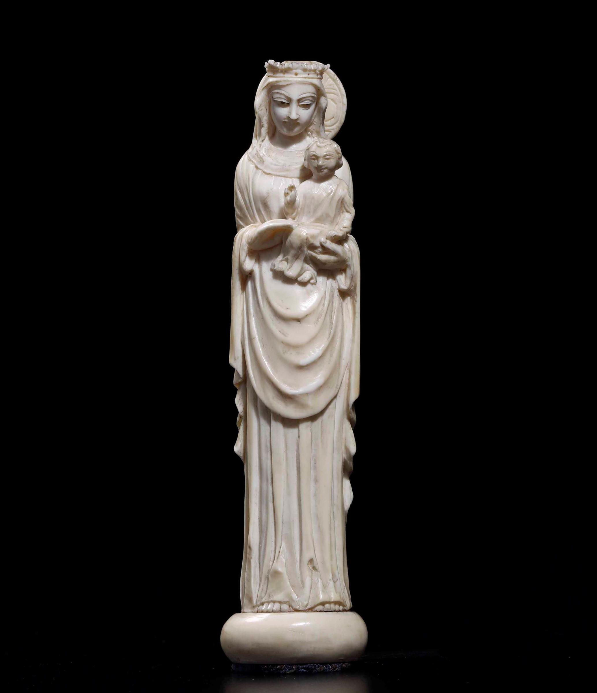 An ivory Madonna, China, 18-1900s - cm 17 -