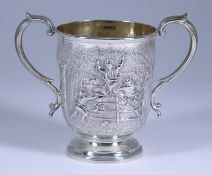 A Victorian Silver Two-Handled Cup, by Daniel & Charles Houle, London 1868, chased and embossed with