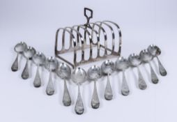 A George V Silver Rectangular Six-Division Toast Rack, a Set of Twelve Edward VII Silver Tea Spoons,