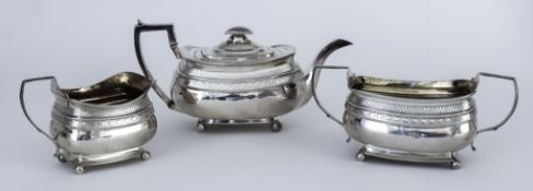 A George IV Harlequin Silver Rectangular Three-Piece Tea Service, by Alice & George Burrows II,