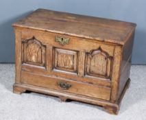 A Mid-18th Century Welsh Oak Coffer Bach, with plain lid, the front with central square fielded