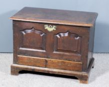 An 18th Century Welsh Oak Coffer Bach, the plain lid with moulded edges, the front with twin