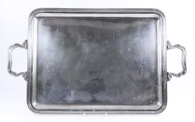 A Continental Silver Rectangular Two-Handled Tray, with moulded rim and shaped and moulded