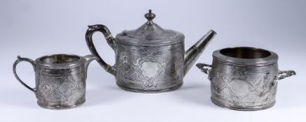 A Victorian Harlequin Silver Circular Three-Piece Tea Service, by Martin, Hall & Co, Sheffield