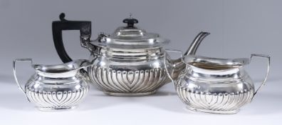 A Late Victorian Bachelors Silver Oval Three-Piece Tea Service, by Charles Boyton, London 1895, with