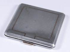 An Edward VIII Silver Square Compact, by Mappin & Webb, London 1936, with engine turned ornament,