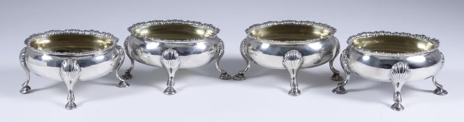 A Harlequin Set of Four George III and Victorian Silver and Silver Gilt Oval Salts, three by