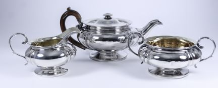 A George IV Silver Circular Three-Piece Tea Service, by William Eley & Charles Price, London 1827,