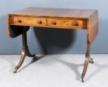 A George III Rosewood Sofa Table, with D-shaped flaps, inlaid in boxwood and contrasting stringings,