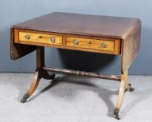 A George III Mahogany Sofa Table, with triple reeded edge to top and D-shaped flaps, fitted two real