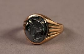 GENT'S 9ct GOLD SIGNET RING set with an OVAL HAEMATITE INTAGLIO of a warrior's head, 5.6gms, ring