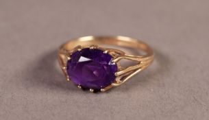 9ct GOLD RING WITH AN OVAL AMETHYST in a twelve claw setting, Birmingham 1973, 2.3gms