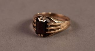 GENT'S 9ct GOLD RING with an oblong garnet, in a ten claw setting, 4.5gms, ring size Q