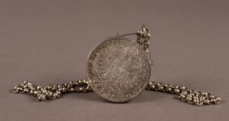 RE-STRIKE 1780 MARIA THERESA THALER, in a loose silver frame, as a pendant on a SILVER BELCHER CHAIN