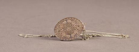 ELIZABETH II SILVER JUBILEE OVAL PENDANT 1977, chased with symbols representing the United