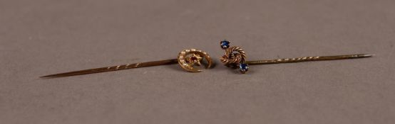 15ct GOLD STICK PIN with knot pattern top set with two tiny sapphires and an 18ct GOLD STICK PIN,