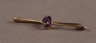 9ct GOLD BAR BROOCH collet set with an oval amethyst, 2.8gms