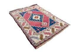 SHIRVAN CAUCASIAN EMBOSSED RUG, with large centre medallion with stepped sides and diamond shaped