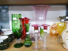 PAIR OF GLASS CANDLESTICKS, LARGE COLOURED VASE, TWO RED VASES HAVING EMBOSSED DECORATION AND