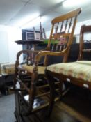 A LATE VICTORIAN BEECHWOOD ROCKING CHAIR