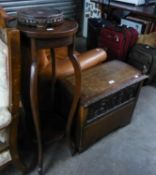 A SMALL OAK CHEST WITH SHALLOW DOMED TOP AND CARVED FRONTAL PANEL, ALSO AN EDWARDIAN PLANT STAND (