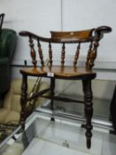 A NINETEENTH CENTURY SPINDLE BACK, LOW BACK SMOKERS ARMCHAIR